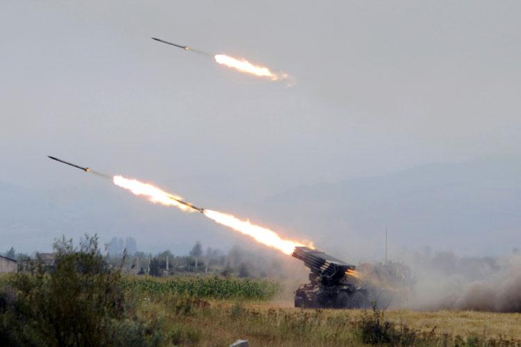 Georgian troops fire artillery at South Ossetian separatist territory near a settlement of Ergneti