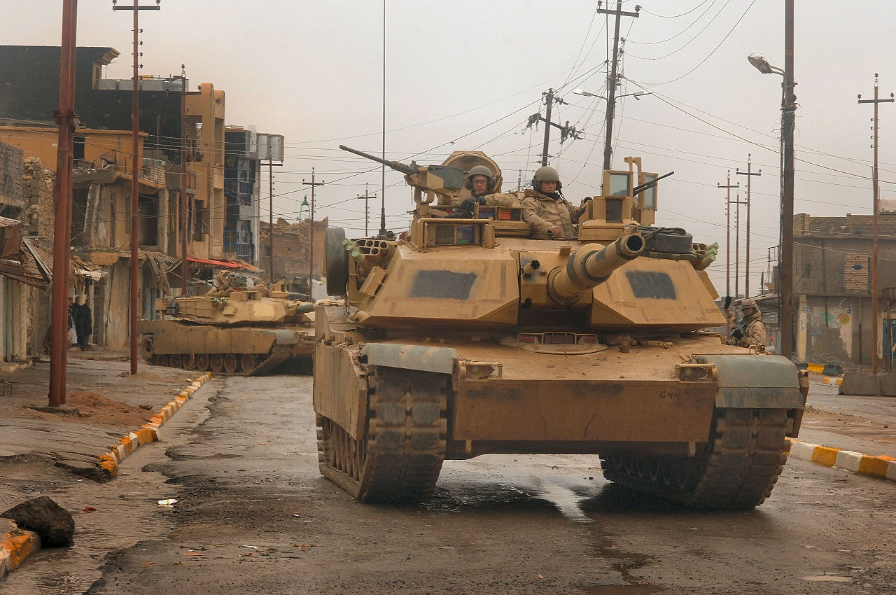 U.S. Army M1 Abrams tanks maneuver in the streets as they conduct a combat patrol in the city of Tall Afar, Iraq, on Feb. 3, 2005. The tanks and their crews are attached to the 3rd Armored Cavalry Regiment. DoD photo By Staff Sgt. Aaron Allmon, U.S. Air Force. (Released)